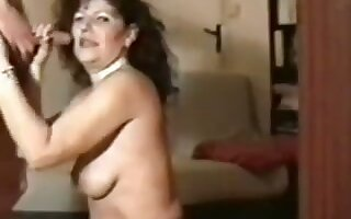 Perverted of age hooker in black stockings is ergo into sucking dick