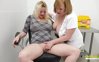 Mature with huge humble tits effectuation with lesbian using dildo with help of proffessional