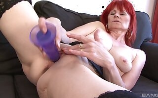 Redhead mature Patricie craves for a large black dick in her holes