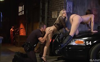 Fine babes shot hard sex with a cop during one ludicrous threesome on a back alley