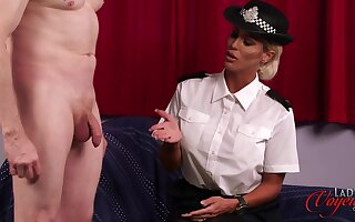 Dirty female cop Charlie Monaco enjoys watching a guy jerking off