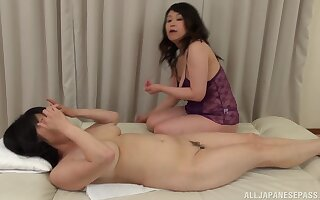 Chubby Japanese adult gets her pussy pleasured by Mizuno Yoshie