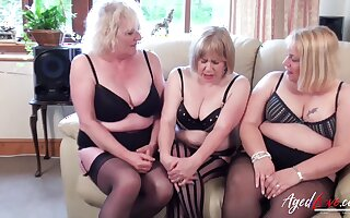 Three mature girls captured while bringing off about one huge added to horny piece of muscle