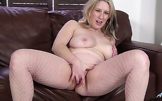 Mel Harper enjoys pleasuring the brush cravings on a leather couch
