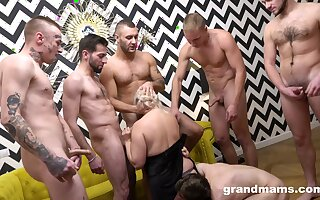 Older broad offers up their way holes all over a bevy of blokes during imprecise gangbang
