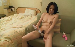 Asian mature toys himself in a guest-house square footage