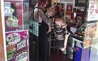 Lesbian whore endures nasty bondage moments at the shop