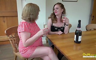 Two horny mature lesbians slowly stripping and playing with their huge boobs