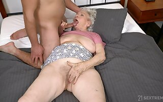 Dirty granny Norma B spreads her legs to be fucked by a stud