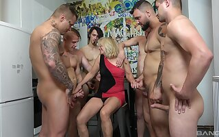 Blonde mature wife Mia on her knees pleasuring a lot of guys