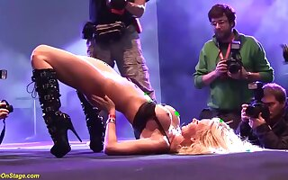 Flexible german MILF naked on public stage