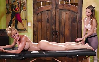 Brandi Love and Jill Kassidy are making love on a massage table and moaning during intense orgasms