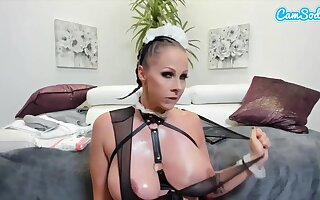 Downhearted woman is toying her pussy after shaving it, while wearing a titillating maid costume