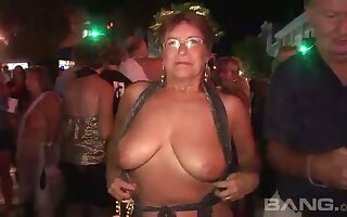 These grown-up women a torch for to flash in public and they've got big natural tits