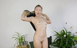 Amateur slut Lira Kissy loves undressing coupled with flashing with her pussy