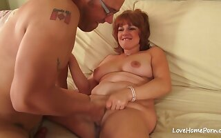 Red haired mature with big tits is wearing high heels while cheating on her husband