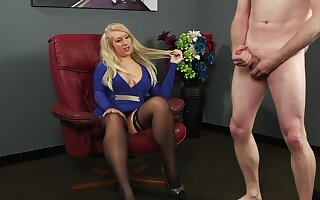 Clothed blonde is surprises to feel such dick in her hands