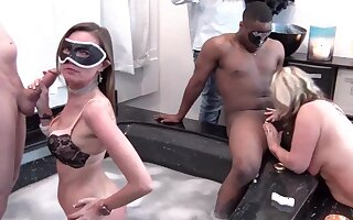 Busty MILFs sucks brute dicks in Jacuzzi at a swingers party