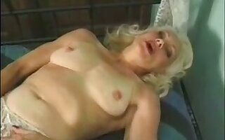 Mature auburn whore masturbates her wet old pussy with a trifle